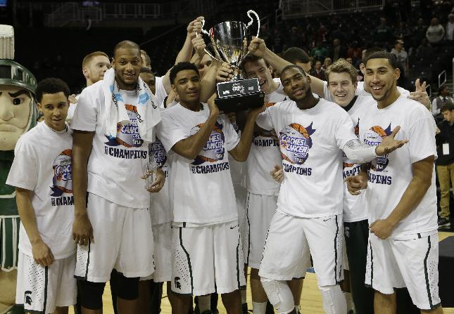 Michigan State's Adreian Payne, second from left, joins Branden Dawson, second from right, Denzel Valentine, right, and other teammates as they celebrate after winning the championship game in the Coaches vs. Cancer NCAA college basketball game against the Oklahoma Sunday, Nov. 24, 2013, in New York. Michigan State won 87-76