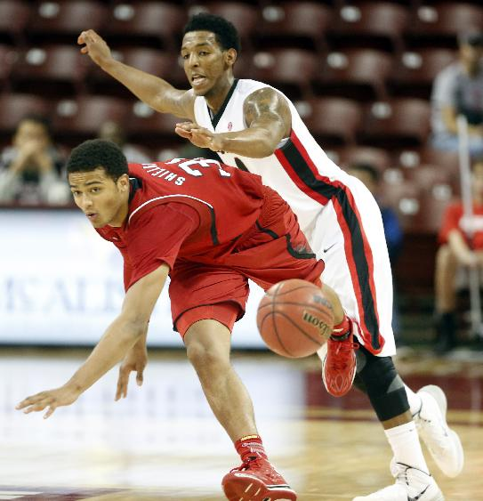 Nebraska's Shavon Shields, left, loses control of the ball against Georgia's Charles Mann in the second half at the Charleston Classic NCAA college basketball tournament in Charleston, S.C., Sunday, Nov. 24, 2013