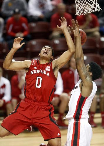 Nebraska's Tai Webster (0) loses control of the ball against Georgia's Charles Mann in the second half at the Charleston Classic NCAA college basketball tournament in Charleston, S.C., Sunday, Nov. 24, 2013
