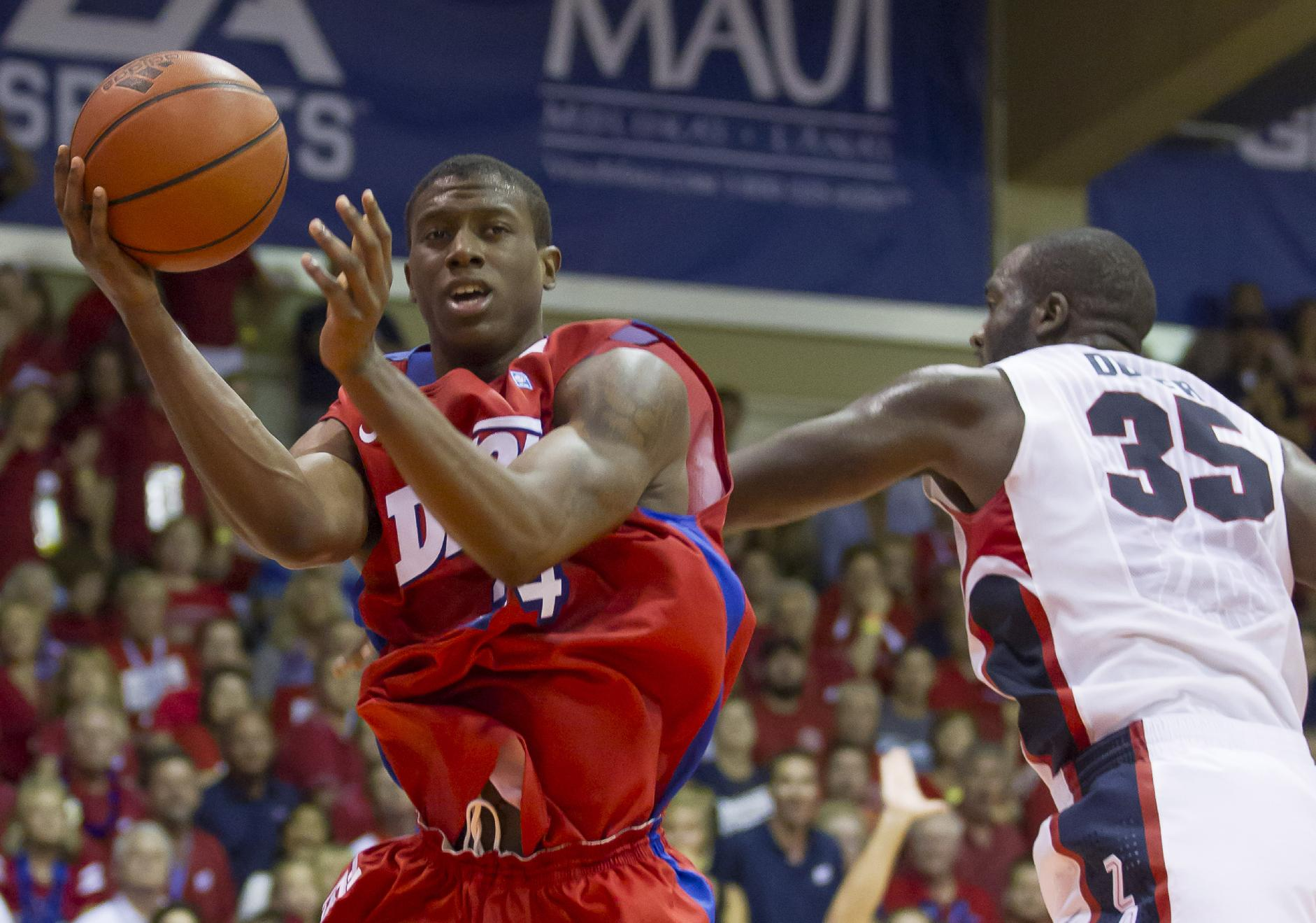 Dayton guard Jordan Sibert looks to pass off the basketball while being defended by Gonzaga center Sam Dower (35) in the second half of an NCAA college basketball game at the Maui Invitational on Monday, Nov. 25, 2013, in Lahaina, Hawaii. Dayton upset Gonzaga 84-79