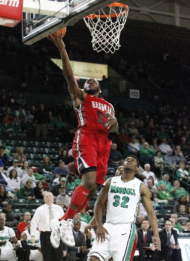 Western Kentucky's T.J. Price, left, gets by Marshall's Tamron Manning for a lay up during the first half of a NCAA men's college basketball game on Tuesday, Nov. 26, 2013, at the Cam Henderson Center in Huntington, W.Va
