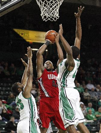 Marshall's Ryan Taylor, left, and TyQuane Goard, right, defend a shot by Western Kentucky's George Fant during the first half of a NCAA men's college basketball game on Tuesday, Nov. 26, 2013, at the Cam Henderson Center in Huntington, W.Va
