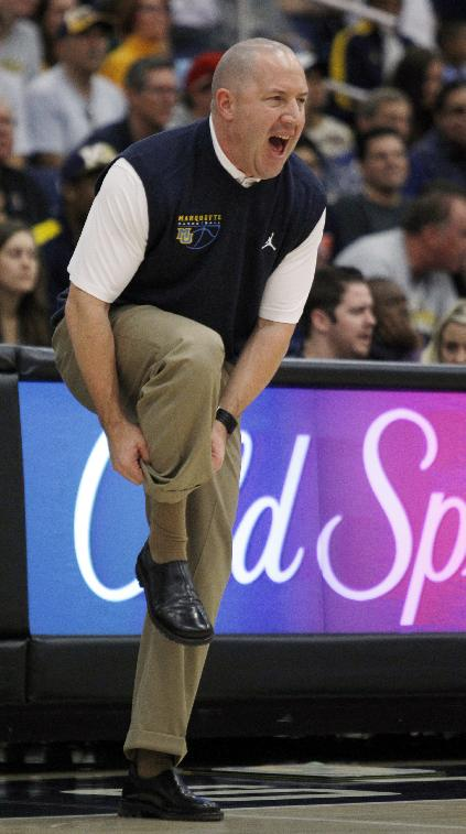 Marquette head coach Buzz Williams adjusts his socks while calling out a defense for his team against Cal State Fullerton in the first half of an NCAA college basketball game at the Wooden Legacy tournament Thursday, Nov. 28, 2013, in Fullerton, Calif