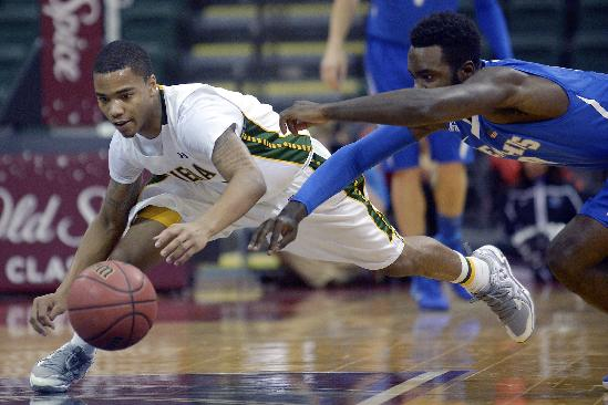 Siena guard Marquis Wright, left, and Memphis guard Damien Wilson dive after a loose ball during the first half of an NCAA college basketball game in Kissimmee, Fla., Thursday, Nov. 28, 2013