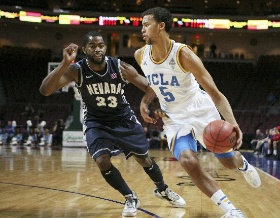 UCLA's Kyle Anderson, right, drives the ball past Nevada's Ronnie Stevens Jr. in the first half of the Las Vegas Invitational NCAA college basketball tournament Thursday, Nov. 28, 2013, in Las Vegas