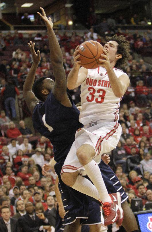 Ohio State's Amadeo Della Valle, right, is fouled by North Florida's Travis Wallace during the second half of an NCAA college basketball game on Friday, Nov. 29, 2013, in Columbus, Ohio. Ohio State won 99-64