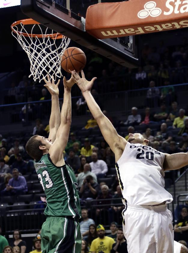 North Dakota forward Chad Calcaterra, left, battles for a rebound with Oregon center Waverly Austin during the first half of an NCAA college basketball game in Eugene, Ore., Saturday, Nov. 30, 2013