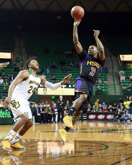 Hardin-Simmons John Barnes (3), right, shoots in front of Baylor's Ish Wainright (24) in the first half of an NCAA college basketball game Sunday, Dec. 1, 2013, in Waco, Texas