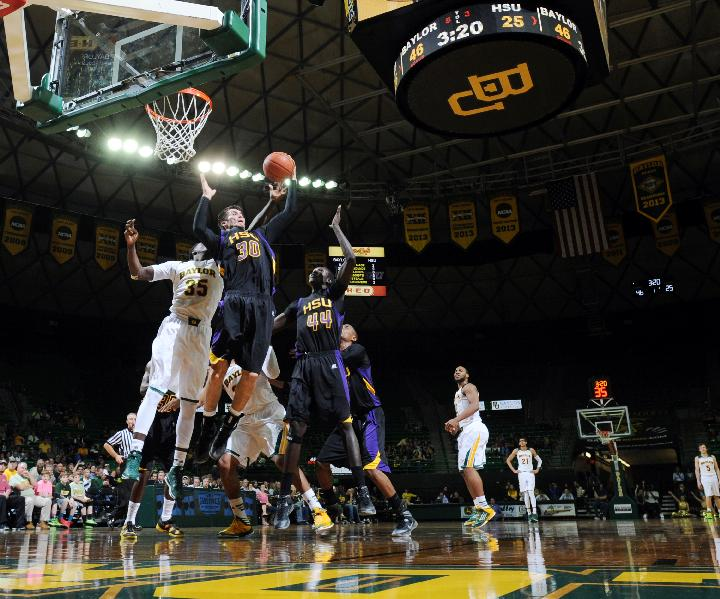 Hardin-Simmons Jim Walker (30) pulls down a rebound over Baylor forward Taurean Prince (35), left, in the first half of an NCAA college basketball game Sunday, Dec. 1, 2013, in Waco, Texas