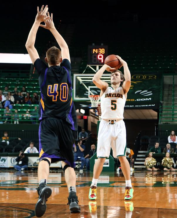 Baylor guard Brady Heslip (5) scores past Hardin-Simmons Justin Jones (40) in the first half of an NCAA college basketball game Sunday, Dec. 1, 2013, in Waco, Texas