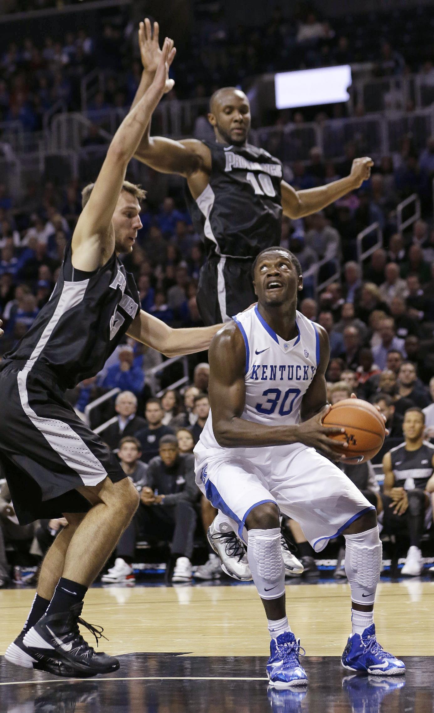 Kentucky's Julius Randle (30) is defended by Providence's Kadeem Batts (10) and Carson Desrosiers (33) during the first half of an NCAA college basketball game Sunday, Dec. 1, 2013, in New York