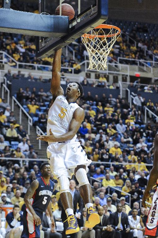 West Virginia's Devin Williams (5) lays in a basket during the second half of an NCAA college basketball game against Gonzaga, Tuesday, Dec. 10, 2013, in Morgantown, W.Va. Gonzaga won 80-76