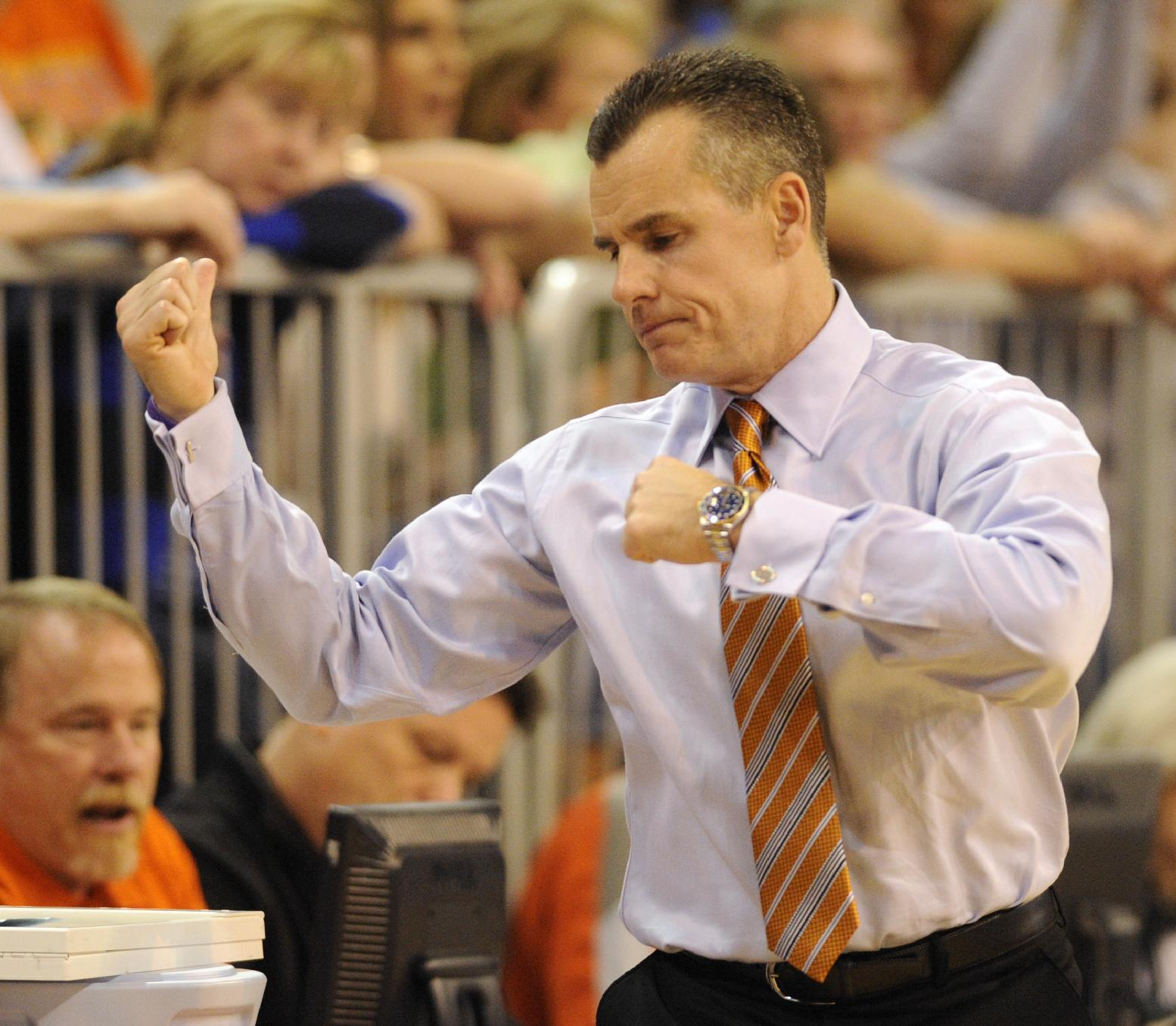 Florida coach Billy Donovan reacts to play on the court during the second half of an NCAA college basketball game against The University of Kansas Tuesday, Dec. 10, 2013 in Gainesville, Fla. Florida won the game 67-61