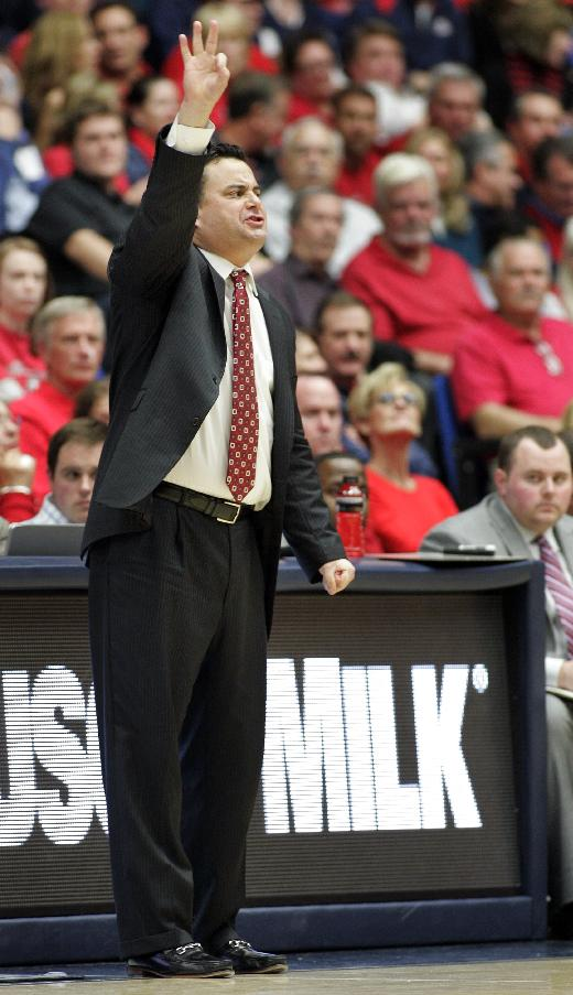 Arizona's head coach Sean Miller calls out a offensive play in the second half against New Mexico State of an NCAA college basketball game on Wednesday, Dec. 11, 2013 in Tucson, Ariz