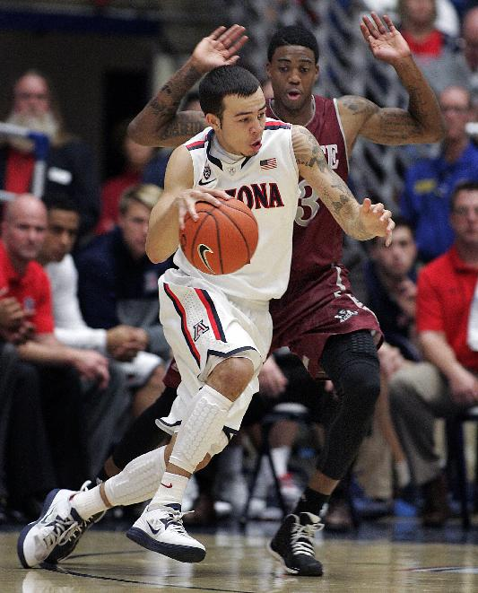 Arizona's Gabe York, in front, drives against the pressing defense of New Mexico States' Daniel Mullings, in back, in the second half of an NCAA college basketball game on Wednesday, Dec. 11, 2013 in Tucson, Ariz. Arizona won 74 - 48