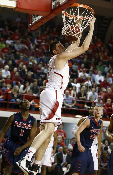 North Carolina State's Jordan Vandenberg (14) dunks against Detroit during the first half of an NCAA college basketball game at Reynolds Coliseum in Raleigh, N.C., Saturday, Dec. 14, 2013