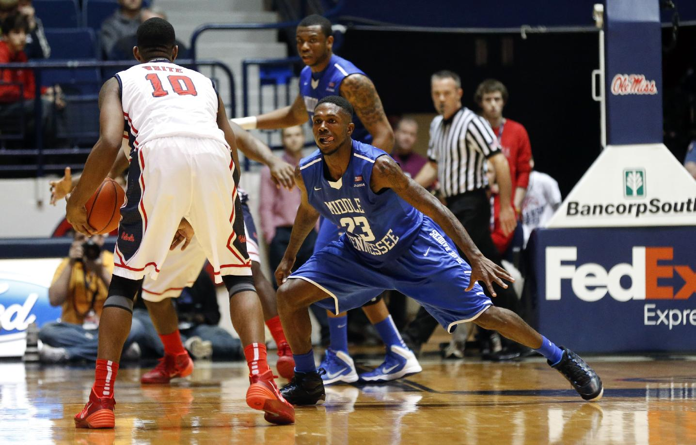 Middle Tennessee State guard Marcus Tarrance (23) defends against Mississippi guard LaDarius White (10) in the second half of an NCAA college basketball game in Oxford, Miss., Saturday, Dec. 14, 2013. Mississippi won 72-63