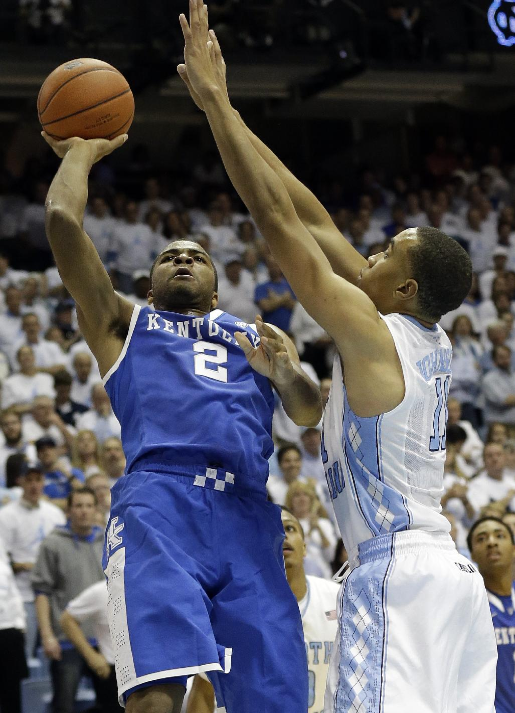 North Carolina's Brice Johnson, right, guards Kentucky's Aaron Harrison (2) during the second half of an NCAA college basketball game in Chapel Hill, N.C., Saturday, Dec. 14, 2013. North Carolina won 82-77