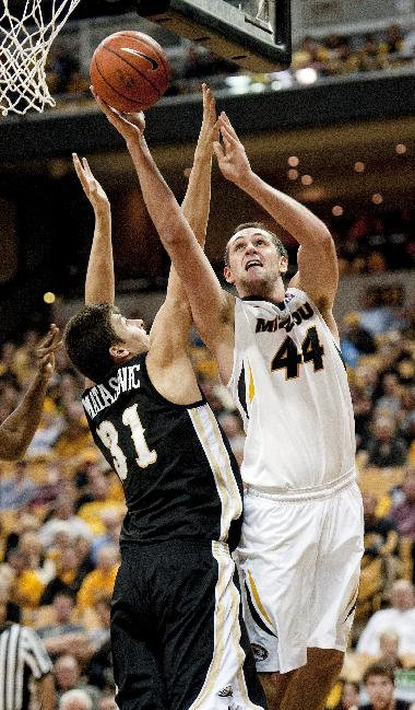 Missouri's Ryan Rosburg, right, shoots past Western Michigan's Mario Matasovic, left, during the first half of an NCAA college basketball game Sunday, Dec. 15, 2013, in Columbia, Mo