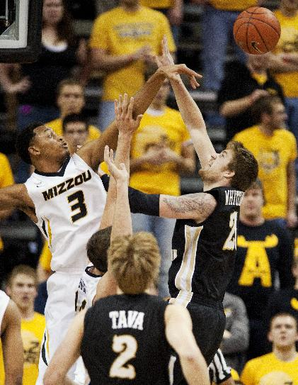 Missouri's Johnathan Williams III, left, blocks the shot of Western Michigan's Shayne Whittington, right, during the first half of an NCAA college basketball game Sunday, Dec. 15, 2013, in Columbia, Mo