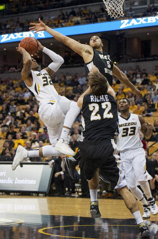 Missouri's Jabari Brown, left, tries to shoot past Western Michigan's David Brown, top, while Earnest Ross, right, and Connar Tava (22) are near during the first half of an NCAA college basketball game Sunday, Dec. 15, 2013, in Columbia, Mo