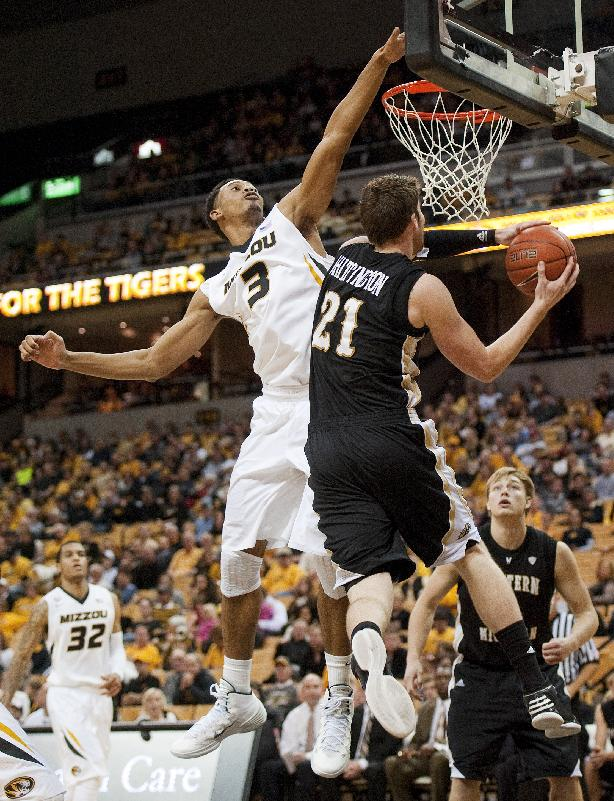 Missouri's Johnathan Williams III, left, tries to block the shot of Western Michigan's Shayne Whittington, right, during the second half of an NCAA college basketball game Sunday, Dec. 15, 2013, in Columbia, Mo. Missouri won 66-60