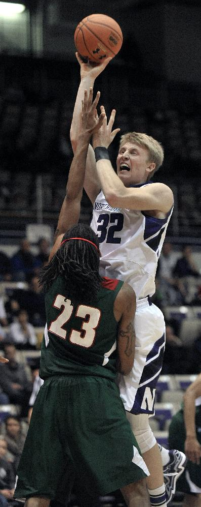 Northwestern's Nathan Taphorn (32) goes up for a shot against Mississippi Valley State's James Currington (23) during the first half of an NCAA basketball game in Evanston, Ill., Monday, Dec. 16, 2013. Northwestern won 86-64