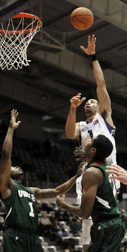 Northwestern's Drew Crawford (1) goes up for a shot against Mississippi Valley State's Blake Ralling (22), and D'Angelo Priar, bottom left, during the first half of an NCAA basketball game in Evanston, Ill., Monday, Dec. 16, 2013