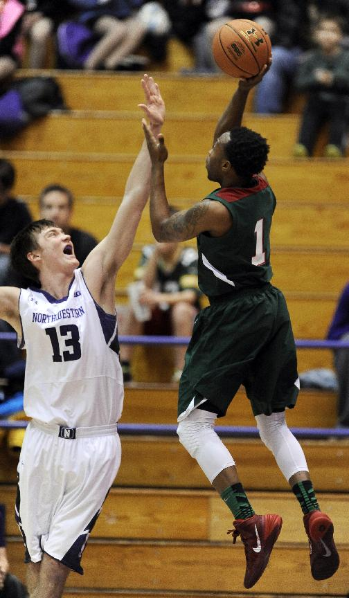 Northwestern's Kale Abrahamson (13) defends Mississippi Valley State's D'Angelo Priar (1) during the first half of an NCAA college basketball game in Evanston, Ill., Monday, Dec.,16, 2013. Northwestern won 86-64
