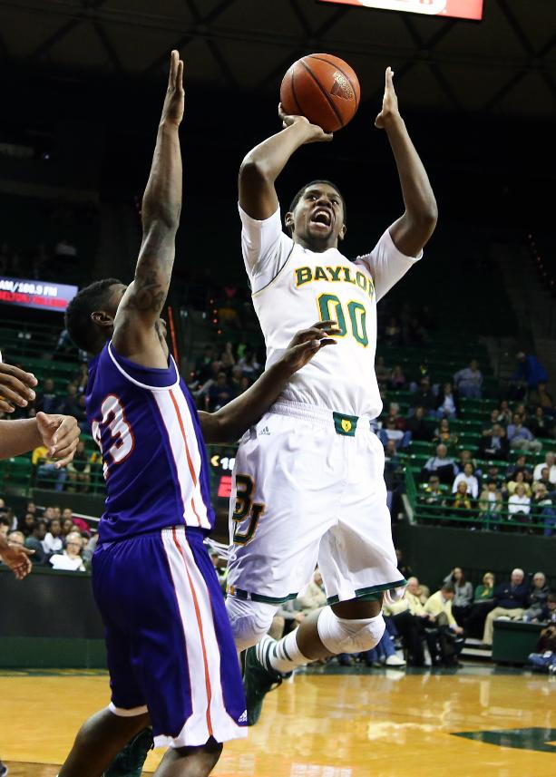Baylor's Royce O'Neale, right, shoots over Northwestern State guard Zikiteran Woodley during the first half of an NCAA college basketball game, Wednesday, Dec. 18, 2013, in Waco, Texas