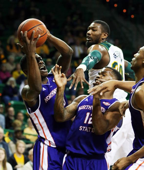 Northwestern State guard Zikiteran Woodley, left, pulls down a rebound over Baylor forward Cory Jefferson (34) and Northwestern State's Jalan West (12) during the first half of an NCAA college basketball game, Wednesday, Dec. 18, 2013, in Waco, Texas