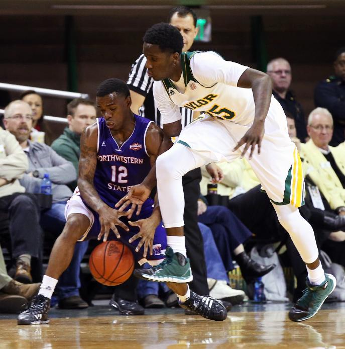 Northwestern State  guard Jalan West (12) reaches for a loose ball with Baylor forward Taurean Prince during the first half of an NCAA college basketball game, Wednesday, Dec. 18, 2013, in Waco, Texas