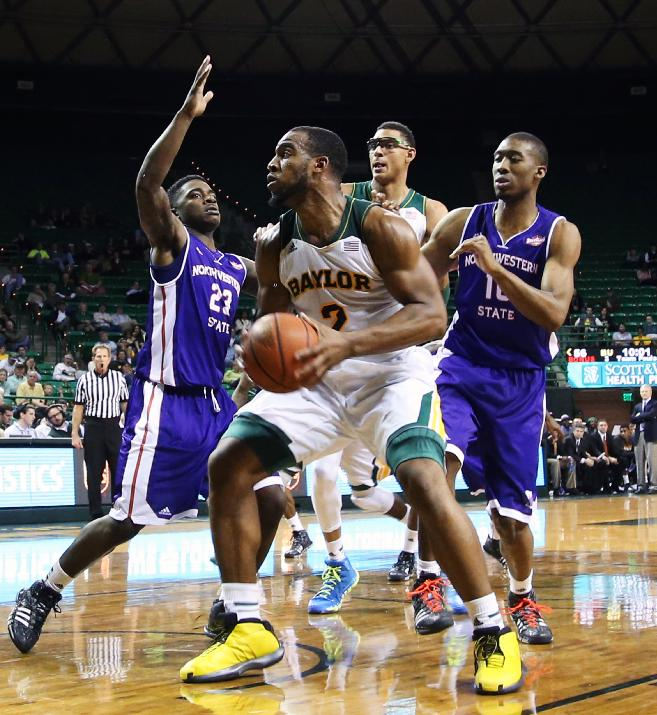 Baylor forward Rico Gathers (2), center, drives to the basket over Northwestern State in the second half of an NCAA college basketball game, Wednesday, Dec. 18, 2013, in Waco, Texas. Baylor won in overtime 91-84