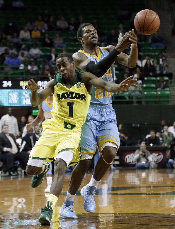 Baylor 's Kenny Chery (1) fouls Southern's Calvin Godfrey (20) as the two compete for the loose ball at mid court in the first half of an NCAA college basketball game, Sunday, Dec. 22, 2013, in Waco, Texas