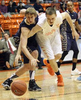 UTEP center Matt Willms, right, chases down a loose ball with Montana State forward Eric Norman during an NCAA college basketball game Monday, Dec. 23, 2013, in El Paso, Texas