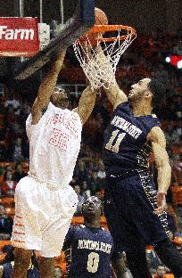 UTEP forward Vince Hunter dunks over Montana State center Paul Egwuonwu in the first half of an NCAA college basketball game Monday, Dec. 23, 2013, in El Paso, Texas