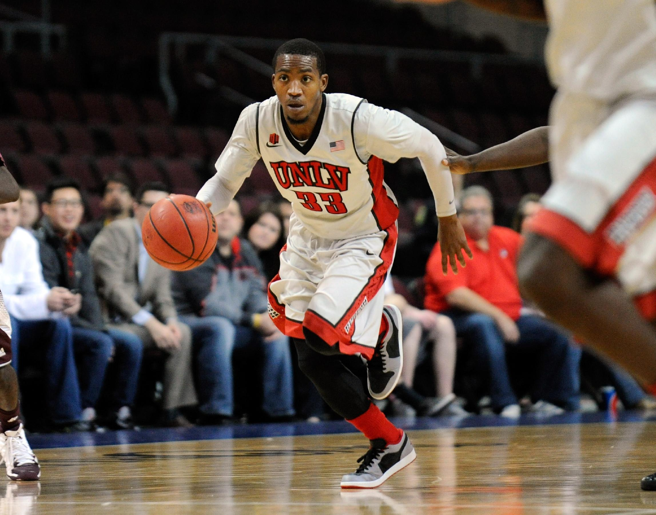 UNLV's Deville Smith (33) drives the ball up the court during an NCAA college basketball game against Mississippi State on Monday, Dec. 23, 2013, in Las Vegas. Smith was named the tournament MVP. UNLV won 82-66