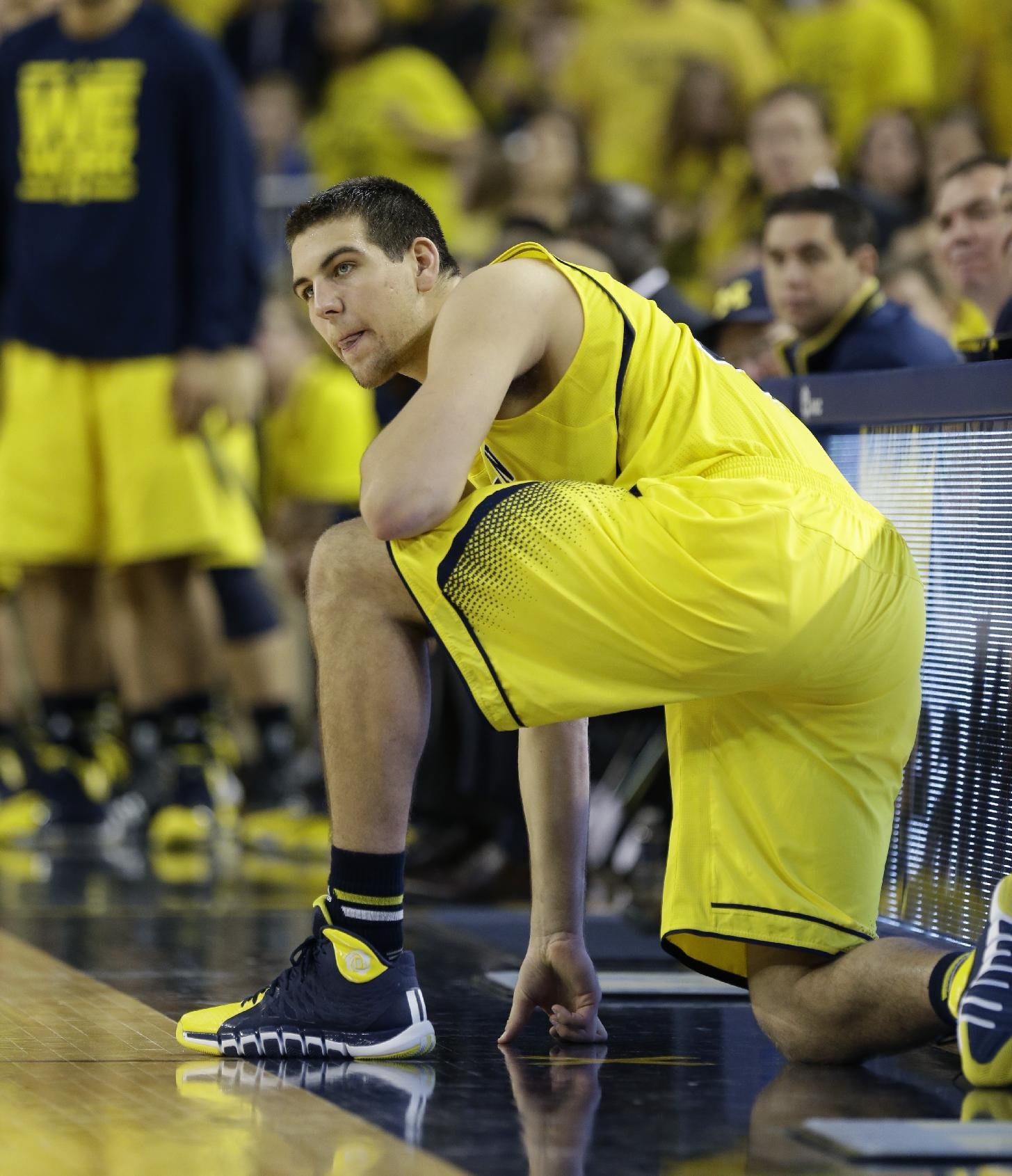 Michigan forward Mitch McGary (4) waits to enter the game during the second half of an NCAA college basketball game against Arizona in Ann Arbor, Mich., Saturday, Dec. 14, 2013
