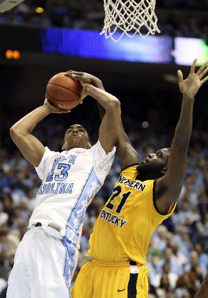 North Carolina's James Michael McAdoo (43) shoots under pressure from Northern Kentucky's Jalen Billups (21) during the second half of an NCAA college basketball game in Chapel Hill, N.C., Friday, Dec. 27, 2013. North Carolina won 75-60