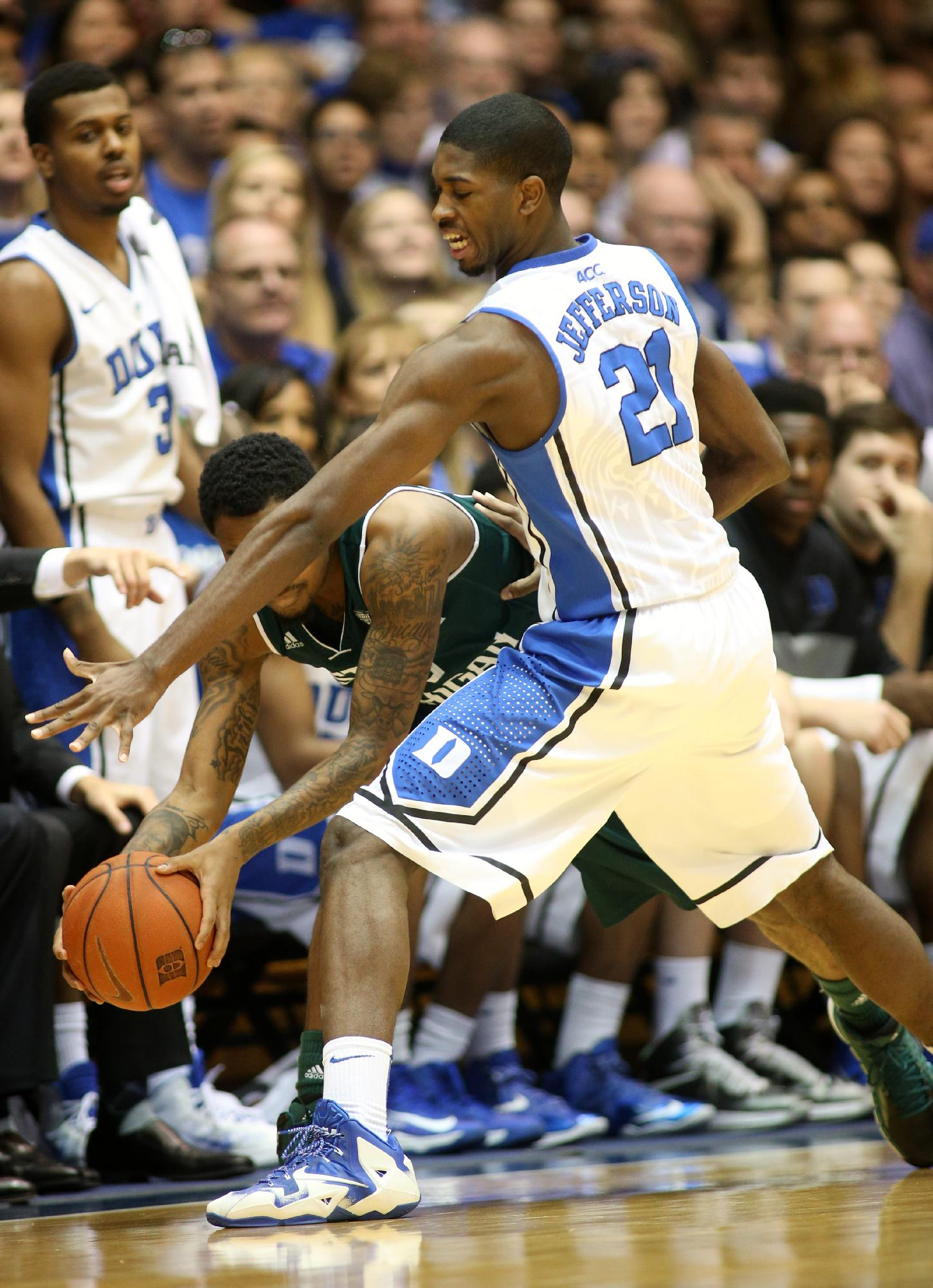 Duke's Amile Jefferson (21) pressures Eastern Michigan's Darrell Combs during the first half of an NCAA college basketball game in Durham, N.C., Saturday, Dec. 28, 2013