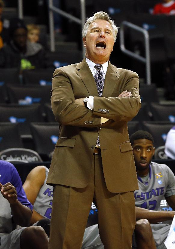 Kansas State's head coach Bruce Weber yells to his team against Tulane during the second half of an NCAA college basketball game Saturday, Dec. 28, 2013, in New York. Kansas State won 72-41