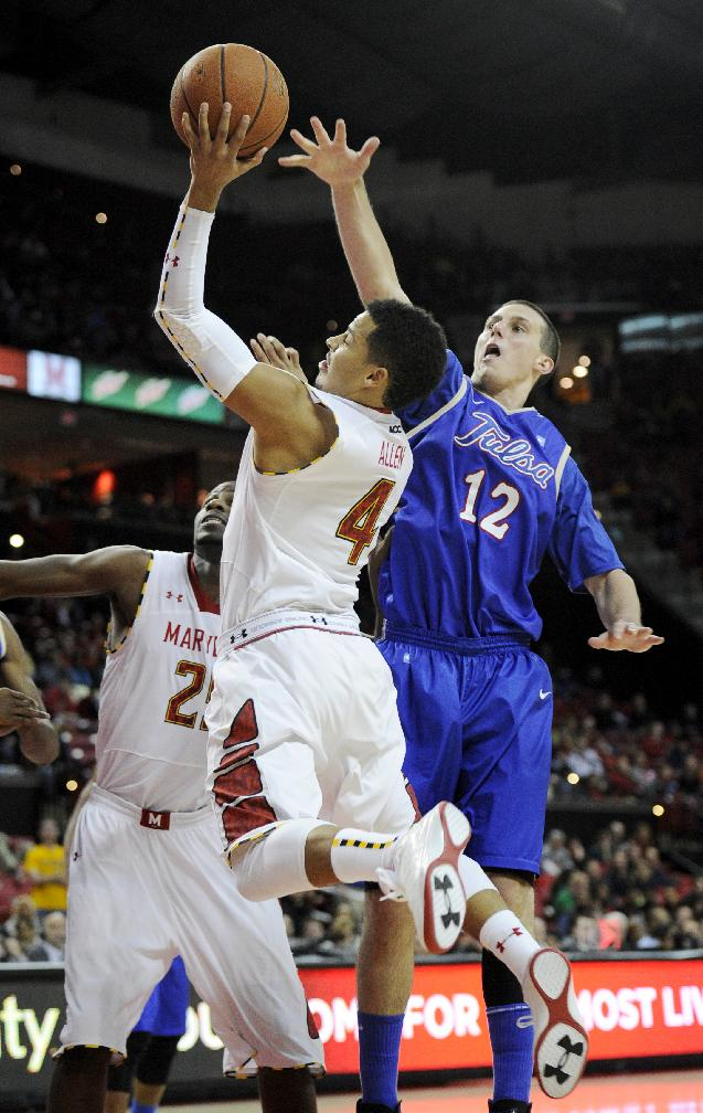 Maryland guard Seth Allen (4) goes to the basket against Tulsa forward Lew Evans (12) during the second half of an NCAA college basketball game, Sunday, Dec. 29, 2013, in College Park, Md. Maryland won 85-74