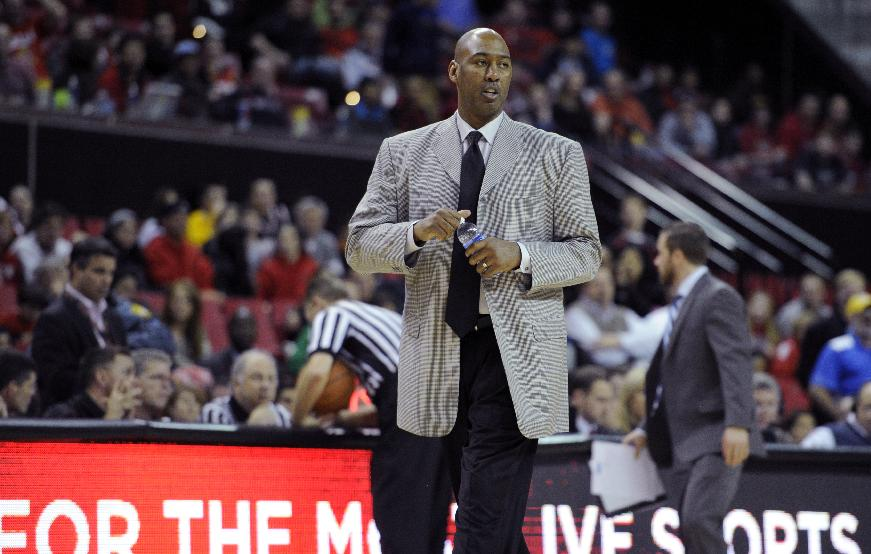 Tulsa head coach Danny Manning looks on as he walks off the court after being getting ejected from the game for getting his second technical foul against Maryland during the second half of an NCAA college basketball game, Sunday, Dec. 29, 2013, in College Park, Md. Maryland won 85-74