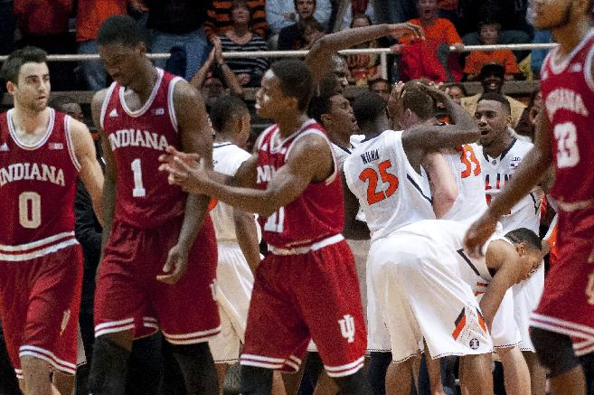Players react to Illinois forward Jon Ekey's (33) steal during the end of overtime of an NCAA college basketball game against Indiana in Champaign, Ill. on Tuesday, Dec. 31, 2013