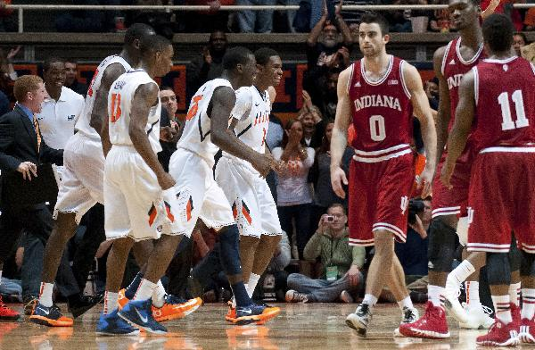 Players react to Illinois forward Jon Ekey's steal during the end of overtime in an NCAA college basketball game against Indiana in Champaign, Ill. on Tuesday, Dec. 31, 2013