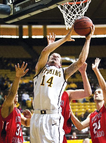 Wyoming guard Josh Adams (14) shoots against Western State during an NCAA college basketball game Wednesday, Jan. 1, 2014, at the Arena Auditorium in Laramie, Wyo