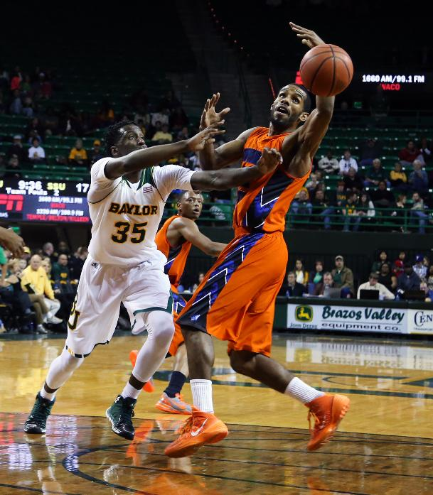 Savannah State forward Joshua Montgomery reaches for a loose ball with Baylor forward Taurean Prince (35) during the first half of an NCAA college basketball game, Friday, Jan. 3, 2014, in Waco, Texas