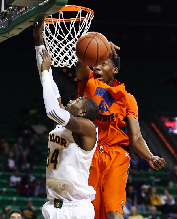 Savannah State forward Jyles Smith (44) blocks the shot of Baylor forward Cory Jefferson, left, during the second half of an NCAA college basketball game, Friday, Jan. 3, 2014, in Waco, Texas