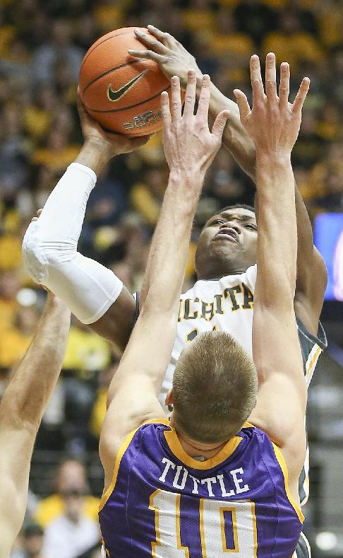 WSU's Cleanthony Early, top, shoots over Northern Iowa's Seth Tuttle during an NCAA college basketball game in Wichita, Kan., Sunday, Jan. 5, 2014
