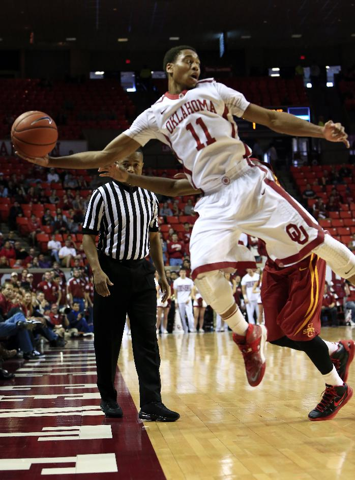 Oklahoma guard Isaiah Cousins goes after a loose ball against Iowa State during the first half of an NCAA college basketball game in Norman, Okla. on Saturday, Jan. 11, 2014